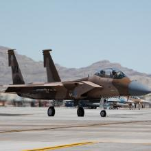 An aggressor aircraft of the 65th Aggressor Squadron prepares to take off at a Red Flag exercise.