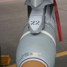 A Maverick missile (inert) sits mounted on the wing of an A-10 Warthog attack aircraft.