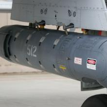 A LANTIRN targeting pod mounted on a weapons pylon of an A-10 attack aircraft.