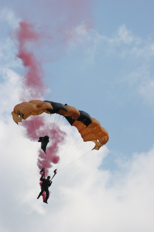 A member of the United States Army parachute team the Golden Knights brings down the POW/MIA flag.