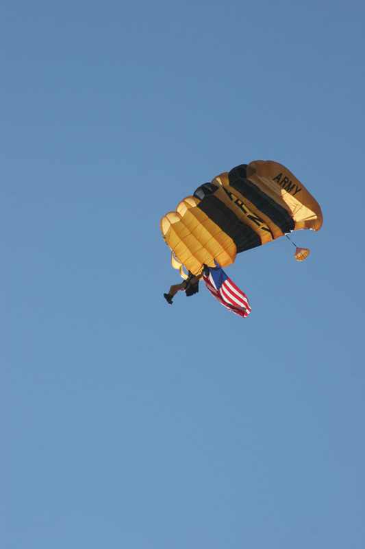 A member of the United States Army parachute team the Golden Knights brings down the United States flag.