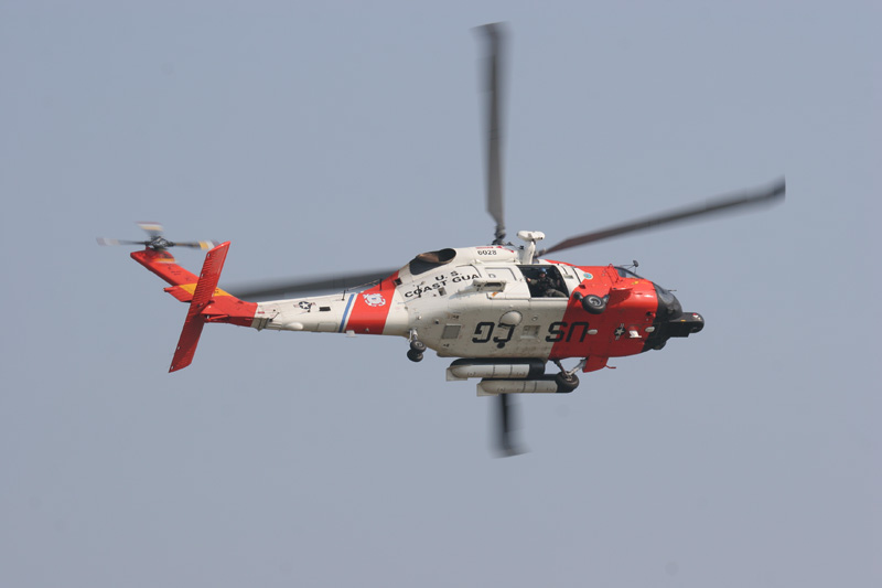 A United states Coast Guard Jayhawk helicopter flies overhead at Air Station Cape Cod in Falmouth Massachusetts.