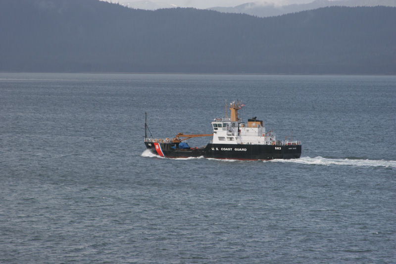A United States Coast Guard coastal buoy tender travels south in the inside passage, Alaska.