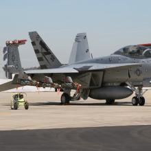 A F/A-18F with photo targets sits on the ramp at NAS Pax River.
